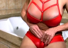 Grown-up shemale in sexy red device strokes bigtits with the addition of t-dick